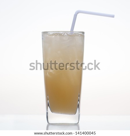 Passion fruit juice with ice in glass isolated on white background