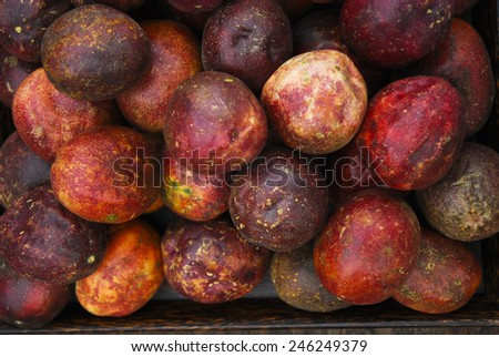 Passion fruits in wicker basket at organic farmers market . - stock photo
