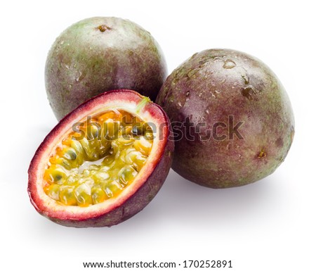 Passion fruits with drops isolated on white background - stock photo