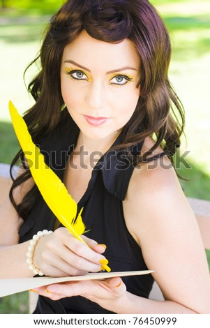 Passion Infatuation And Desire Filled Woman Stares Oncamera In A Happy State Of Romance While Writing A Romantic Love Letter To Her Lover With A Yellow Feather
