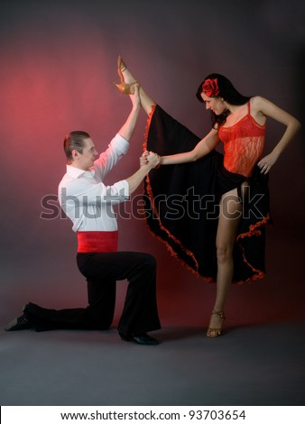 passion latin dancers over grey background