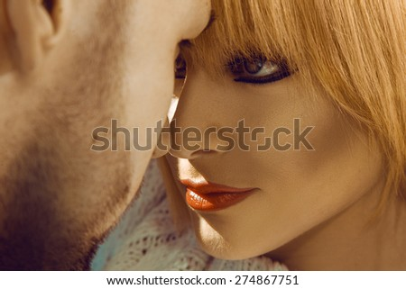 Passion look at each others in young couple outdoors - stock photo