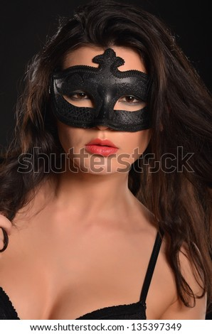 Passion woman in mask - stock photo