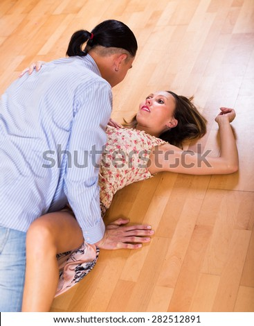 Passionate adult couple having sex on the floor at home - stock photo