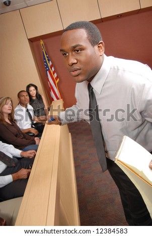 Passionate attorney making a speech in front of the jury box