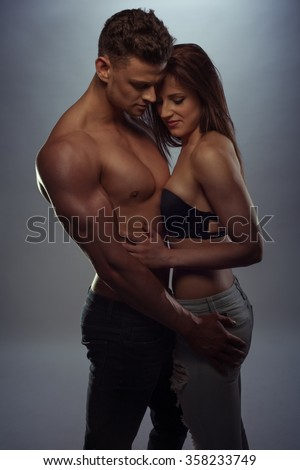 Passionate couple holding each other in love - stock photo