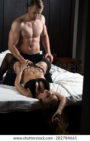Passionate couple in bed  - stock photo