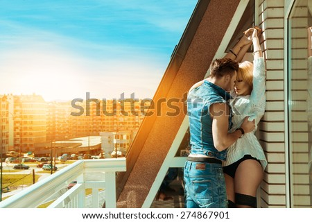 Passionate couple in love seduce each others at summer time - stock photo