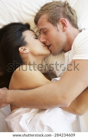 Passionate Couple Kissing In Bed - stock photo