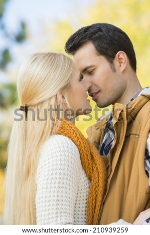 Passionate couple kissing in park