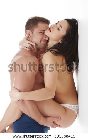 Passionate couple posing. Man smiles at camera - stock photo