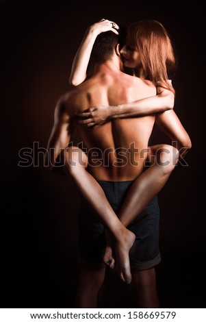 Passionate embraces men and women - stock photo