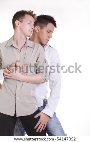 Passionate gay couple spooning - stock photo