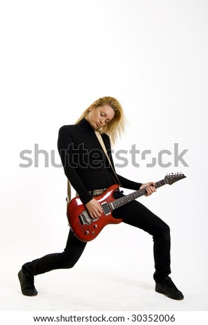 passionate girl playing her electric guitar