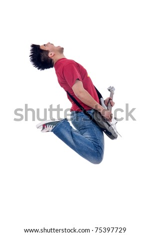 passionate guitarist jumps in the air and screaming - stock photo