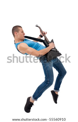 Passionate guitarist playing his electric guitar on white background - stock photo