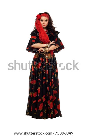 Passionate gypsy woman in a black skirt - stock photo