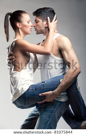 Passionate heterosexual couple in studio - stock photo