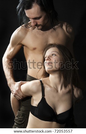 Passionate heterosexual couple on a black background