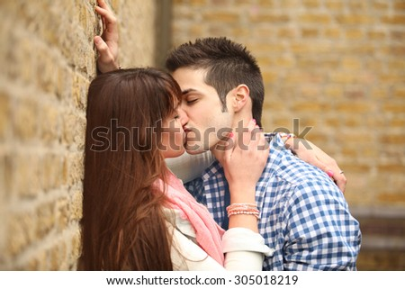 passionate kiss of two young people in love - stock photo