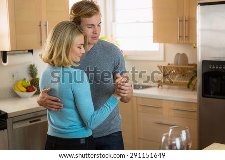 Passionate loving embrace slow dance passionately in love on their anniversary - stock photo