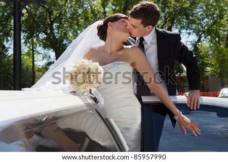 Passionate married couple kissing - stock photo