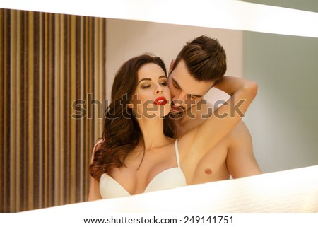 Passionate sensual couple in mirror, foreplay and desire - stock photo