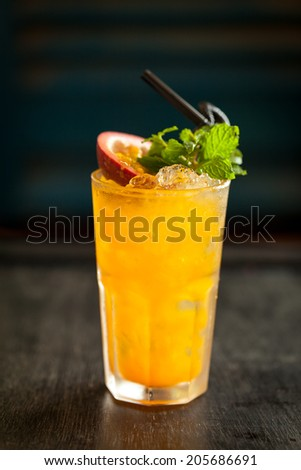 passionfruit ( Chanh Day ) mocktail with dark wooden background - stock photo