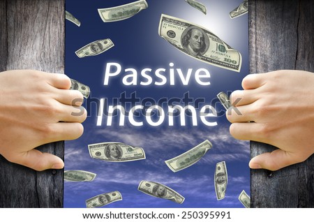 Passive Income and Financial Freedom Concept. Hand opening a wooden door and found a new world to success. - stock photo