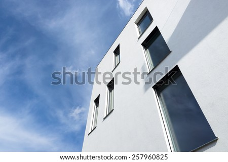 Passive modern building with large windows on a sunny day - stock photo