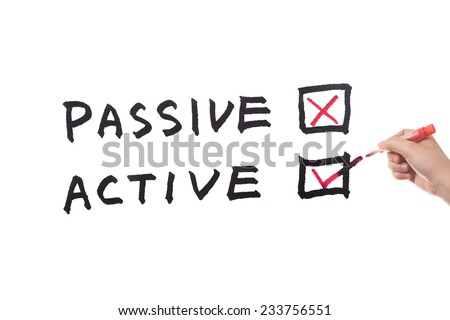 Passive or Active words written on white paper - stock photo