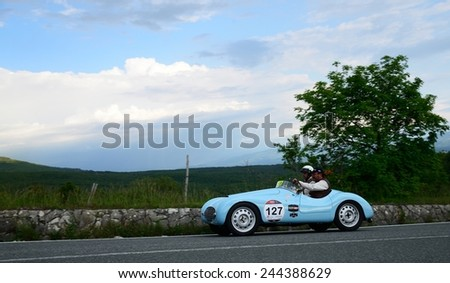PASSO DELLA FUTA (FI), ITALY - MAY 17: A blue FIAT 500 A Sport takes part to the 1000 Miglia classic car race on May 17, 2014 near Passo della Futa (FI). The car was built in 1938 - stock photo