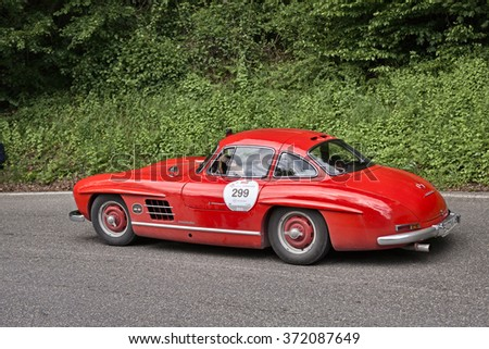 PASSO DELLA FUTA (FI), ITALY - MAY 18: driver and co-driver on old sports car Mercedes Benz 300 SL W 198 (1954) in historic Italian race Mille Miglia on May 18, 2013 in Passo della Futa (FI) Italy