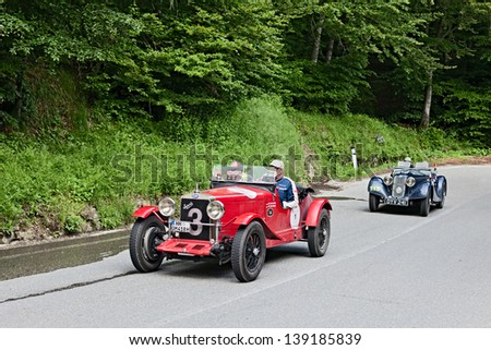 PASSO DELLA FUTA (FI), ITALY - MAY 18: unidentified drivers on an old car O.M. 665 SS (1930) in rally Mille Miglia, the famous italian historical race on May 18, 2013 in Passo della Futa (FI) Italy