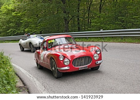 PASSO DELLA FUTA (FI), ITALY - MAY 18: unidentified drivers on an old sports car Fiat 8V (1953) in rally Mille Miglia 2013, the italian historical race (1927-1957) on May 17, 2013 in Ravenna, Italy