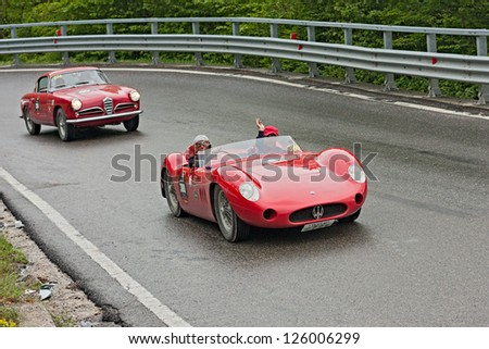 PASSO DELLA FUTA (FI) - MAY 19: unidentified drivers on a racing car Maserati 200SI (1957) runs in rally Mille Miglia 2012, classical endurance race, on May 19, 2012 in Passo della Futa (FI) Italy