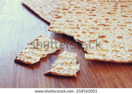 Passover background.matzoh (jewish passover bread) over wooden background. - stock photo