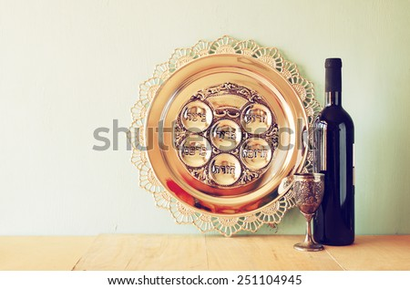 passover background. wine and matzoh (jewish holiday bread) over wooden background.  - stock photo