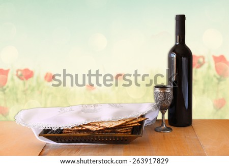 passover background. wine and matzoh (jewish passover bread) on wooden table  - stock photo