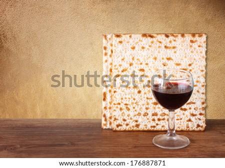 passover background. wine and matzoh (jewish passover bread)  over brown antique background.  - stock photo