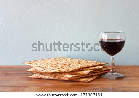 passover background. wine and matzoh over wooden table.  - stock photo