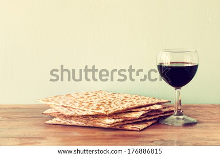 passover background. wine and matzoh over wooden table. vintage effect process. - stock photo