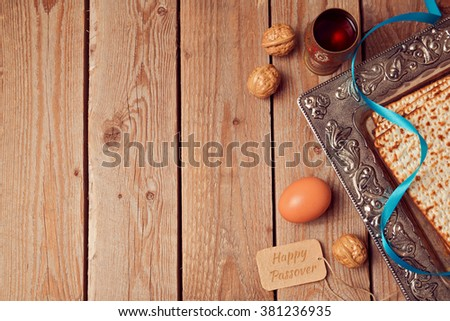 Passover background with matzo, wine and egg. View from above - stock photo