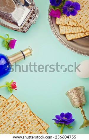 Passover background with matzo, wine and flowers. Jewish holiday celebration - stock photo