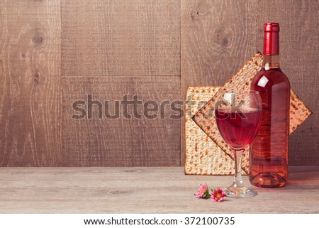 Passover celebration with wine and matzoh on wooden table - stock photo