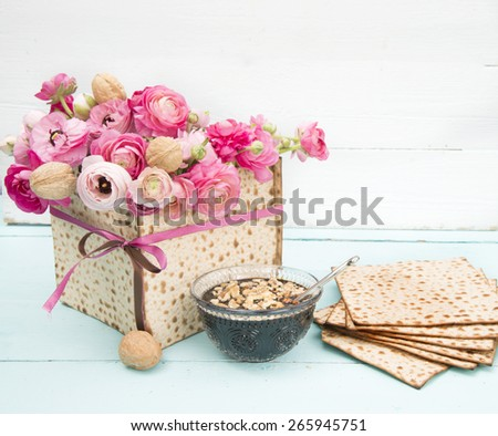 passover centerpiece with matzot flowers and haroset - stock photo