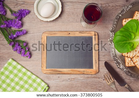 Passover (pesah) holiday celebration with chalkboard and seder plate. View from above - stock photo