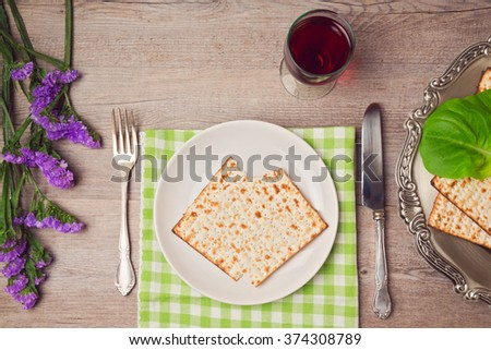 Passover (pesah) holiday table setting with seder plate and matzoh. View from above - stock photo