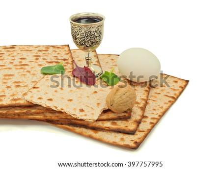 Passover plate, wine cup and matzoh (Jewish Passover bread) all isolated on white background - stock photo