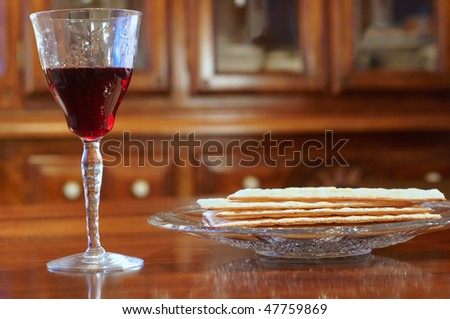Passover wine and matzoh on a table at eye level - stock photo